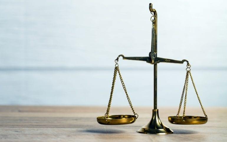 Dilemma afwegen balansschaal